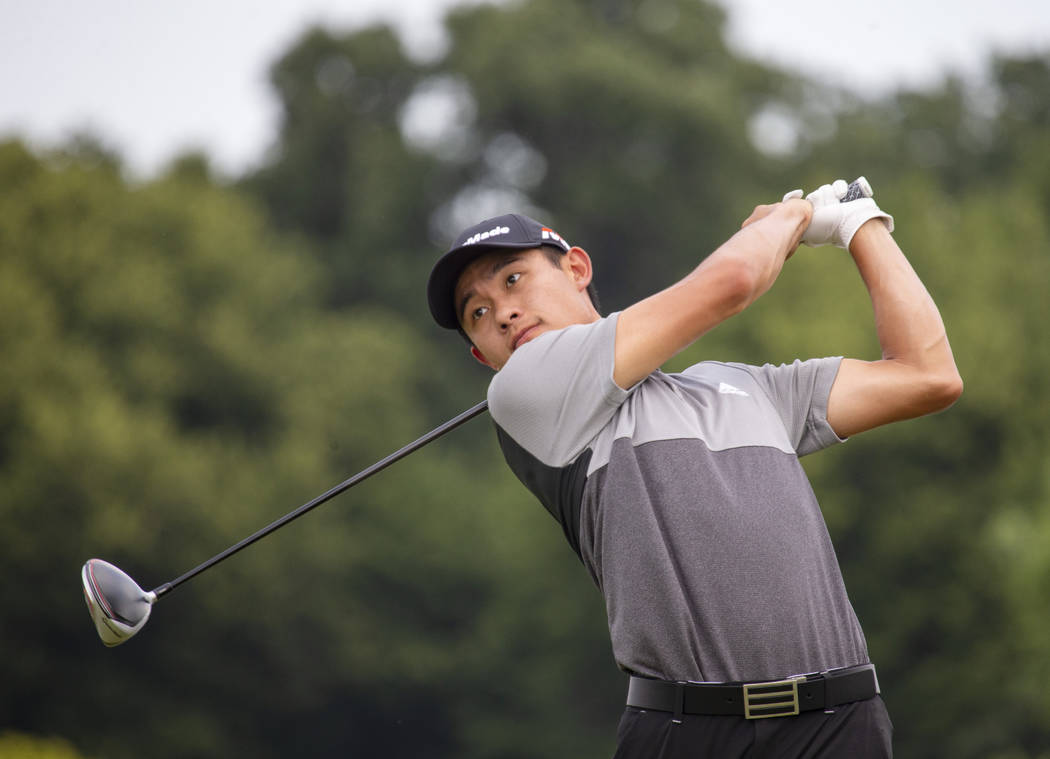 Collin Morikawa tees off on the first hole during the final round of the 3M Open golf tournamen ...