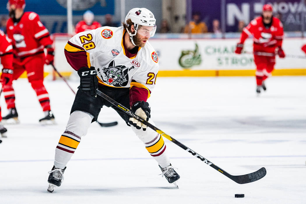Chicago Wolves defenseman Jake Bischoff handles the puck in Game 2 of the Calder Cup Final agai ...