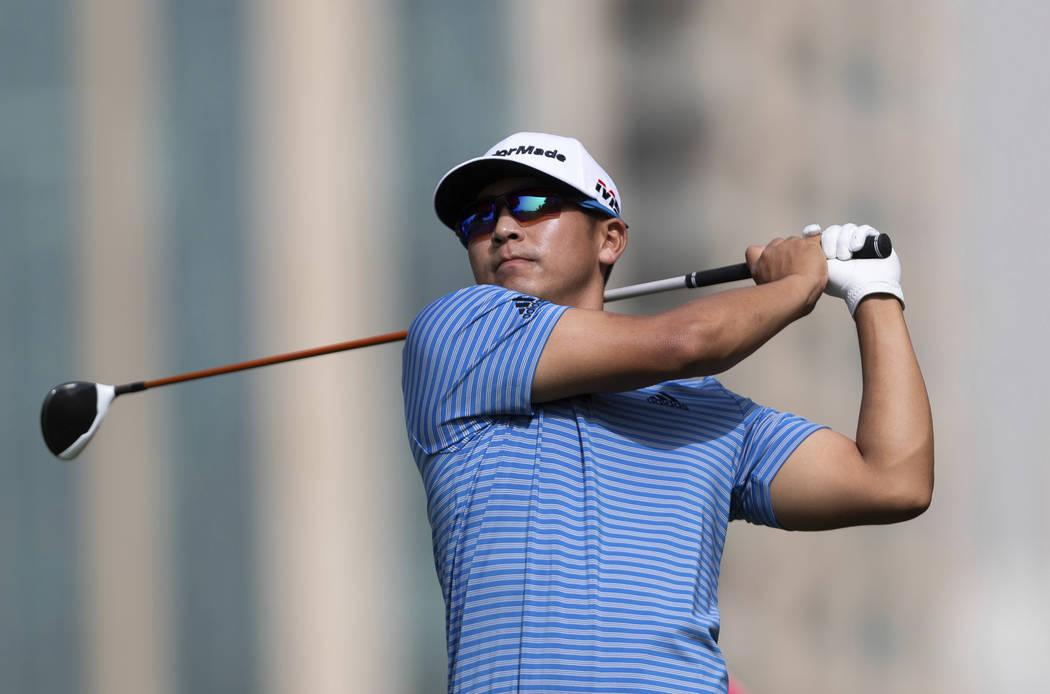 Kurt Kitayama of the U.S. tees off on the 5th hole during round one of the Dubai Desert Classic ...
