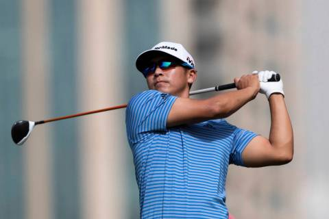 Kurt Kitayama of the U.S. tees off on the 5th hole during round one of the Dubai Desert Classic ...