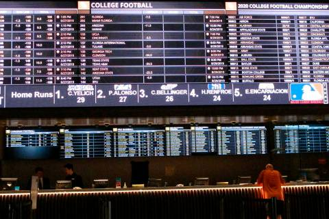 A gambler places a bet at the new sportsbook at Bally's casino in Atlantic City, N.J. on June 2 ...