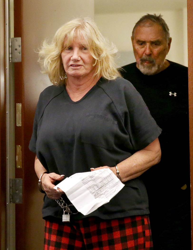 Patricia Chappuis, followed by her husband, Marcel, appear in court at the Regional Justice Cen ...