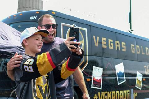 Former Golden Knights defenseman Brad Hunt takes a selfie with a young fan at a team event in ...