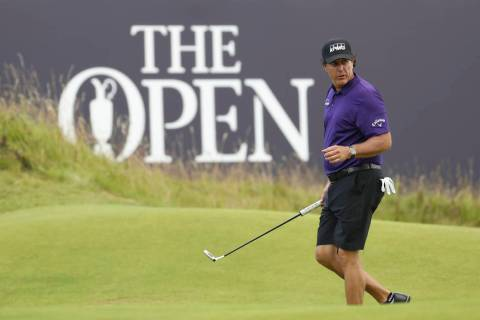 Phil Mickelson of the United States walks on the 18th green during a practice round ahead of th ...