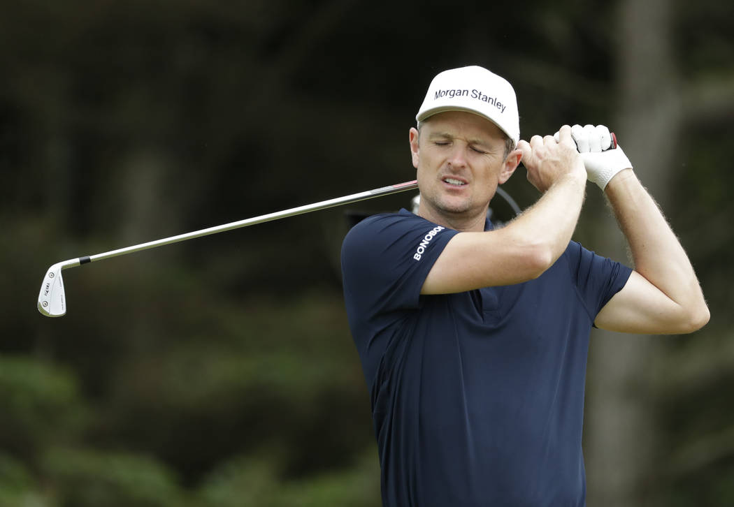 England's Justin Rose reacts after playing his second the shot from the 5th during a practice r ...