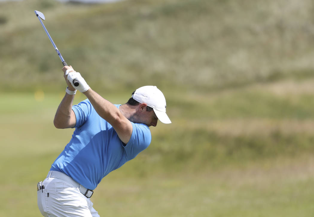 Northern Ireland's Rory McIlroy hits shot on the practice range ahead of the start of the Briti ...