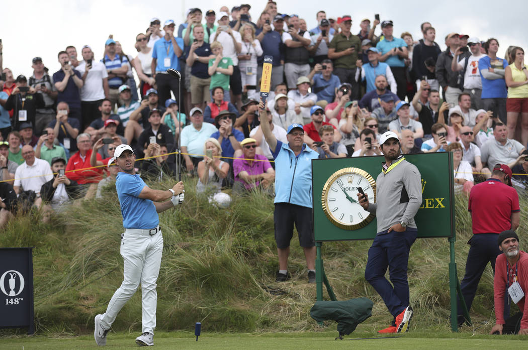 Northern Ireland's Rory McIlroy plays his shot off the 7th tee watched by spectators during a p ...