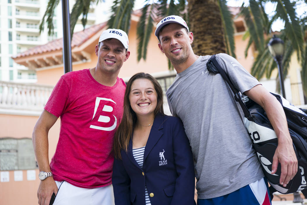 Cherrial Odell, center, poses for a portrait with Bob Bryan, left, and Mike Bryan after a tenni ...