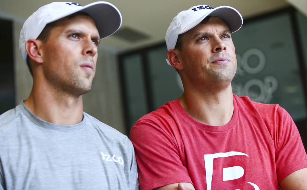 Mike Bryan, left, and Bob Bryan talk about Cherrial Odell, a local amatuer tennis player that t ...