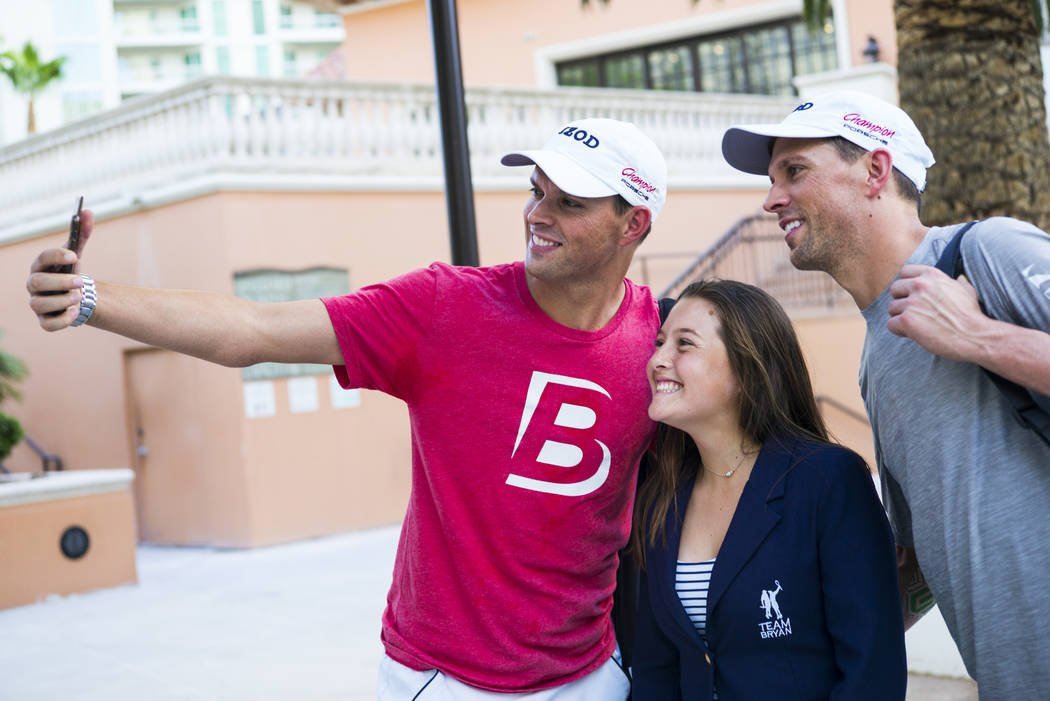 Cherrial Odell, center, poses for a selfie with Bob Bryan, left, and Mike Bryan after a tennis ...