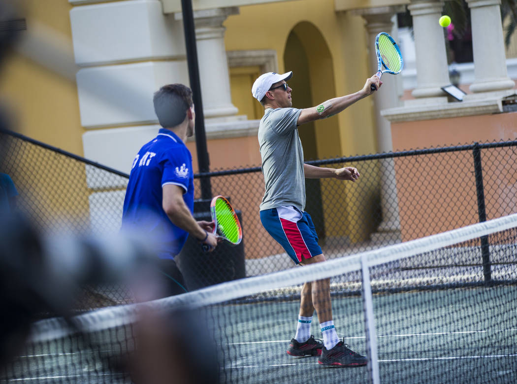 Mike Bryan helps lead a tennis clinic held at the Stirling Club at Turnberry Place in Las Vegas ...
