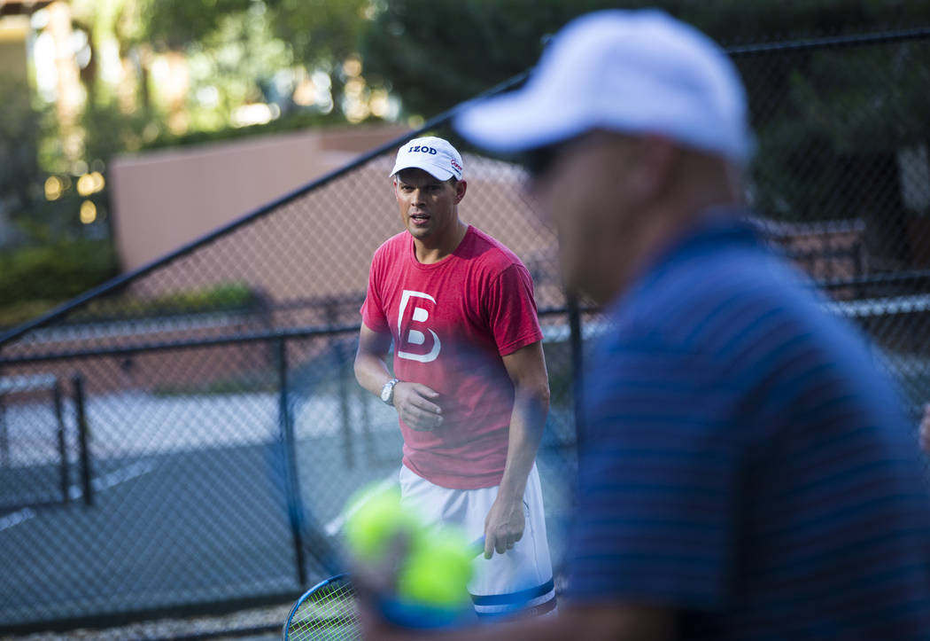 Bob Bryan helps lead a tennis clinic held at the Stirling Club at Turnberry Place in Las Vegas ...