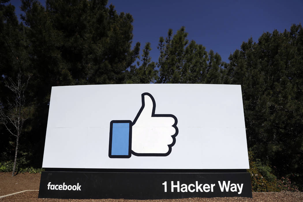 A March 28, 2018, file photo shows a Facebook logo at the company's headquarters in Menlo Park, ...