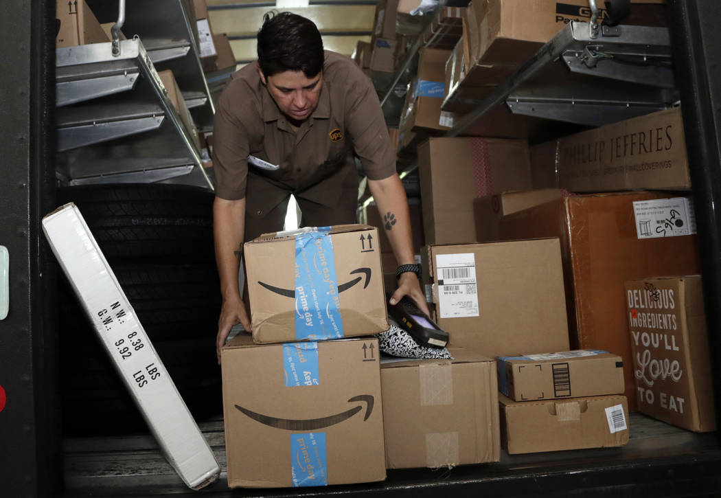 FILE - In this July 17, 2018, file photo UPS employee Liz Perez unloads packages for delivery i ...