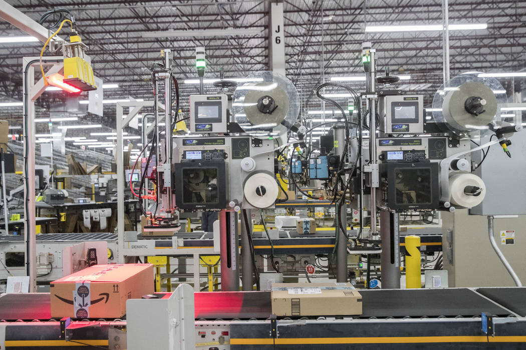 In this Dec. 5, 2018, photo mailing labels are placed on boxes at the Amazon fulfillment center ...