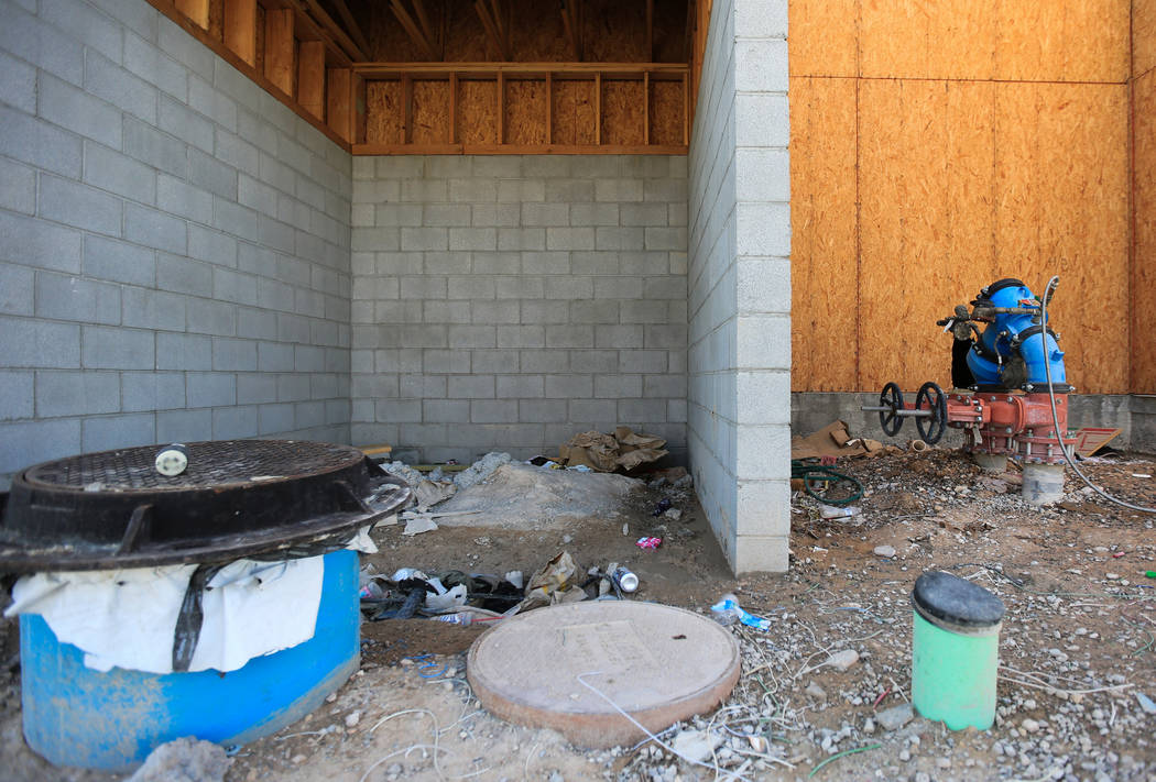 Trash piles up on the back of the Treehouse Las Vegas building at 1022 S. Main Street in Las Ve ...