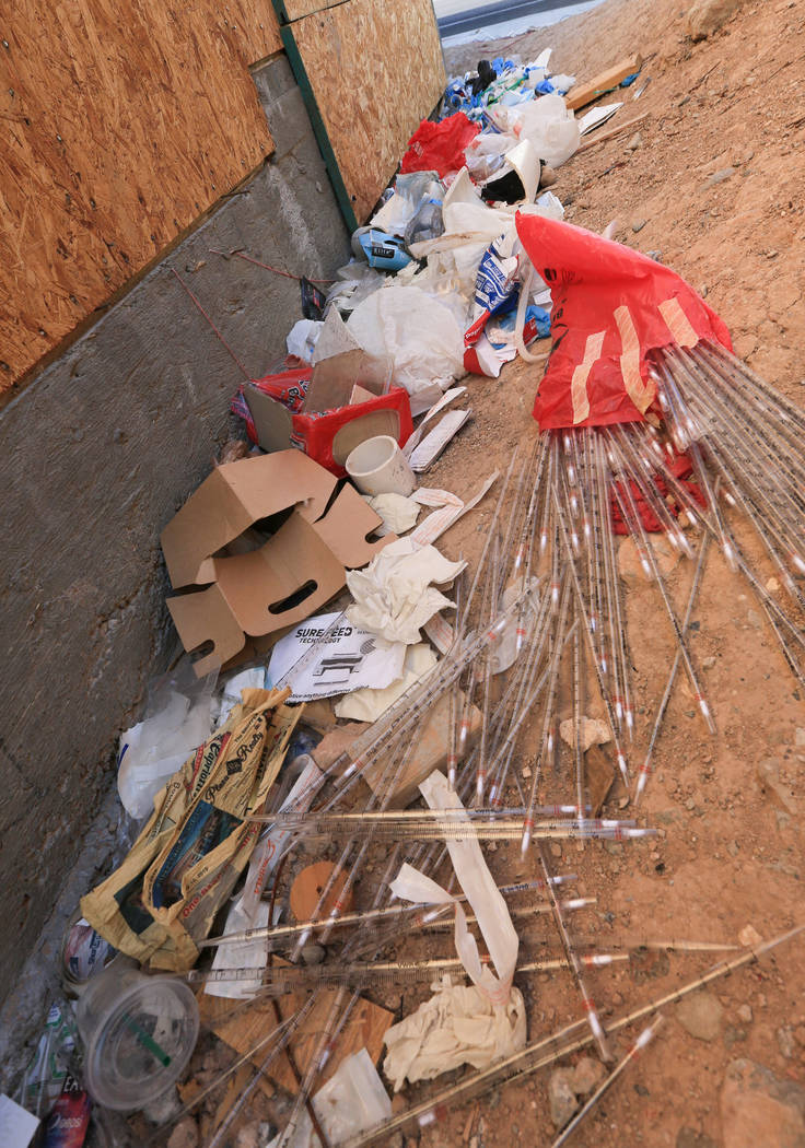 Trash piles up against the Treehouse Las Vegas building at 1022 S. Main Street in Las Vegas on ...