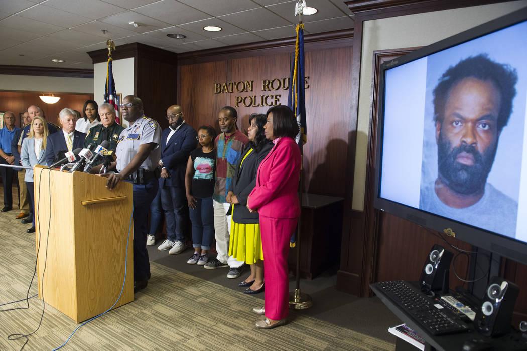 Baton Rouge area law enforcement officials including BRPD Chief Murphy Paul, at lectern, announ ...