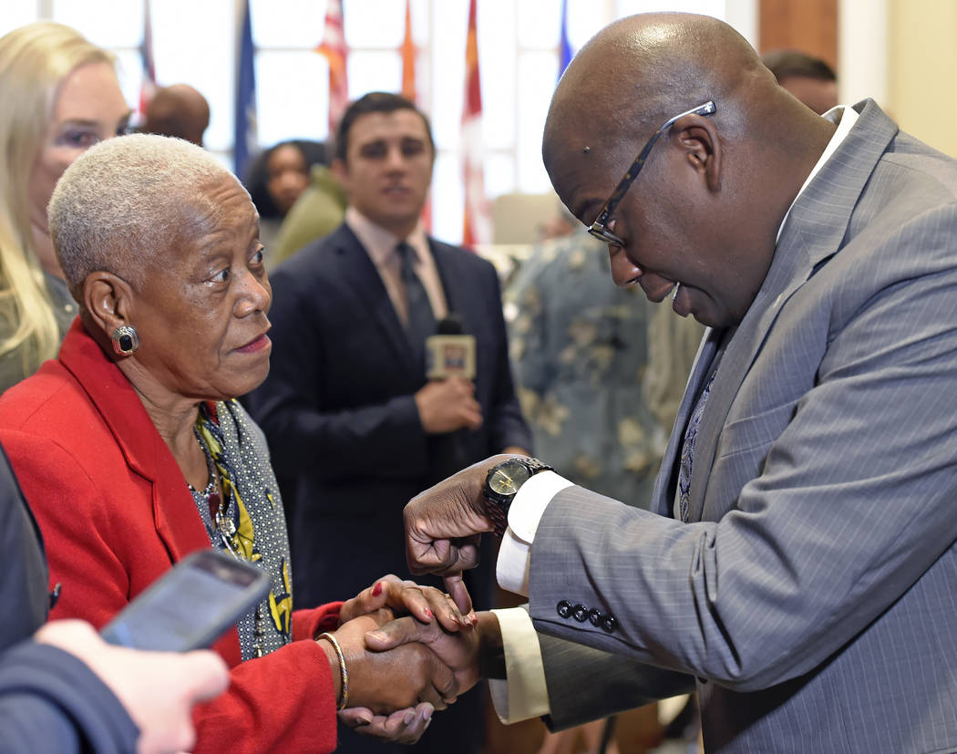 In a Friday Dec. 29, 2017 photo, Sadie Roberts-Joseph, left, chats with Louisiana State Police ...
