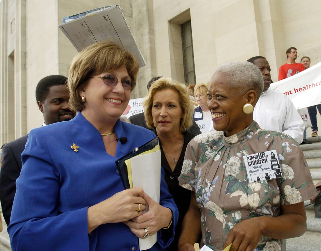 FILE - In an April 2004 file photo, Gov. Kathleen Blanco, left, talks with Sadie Roberts-Joseph ...