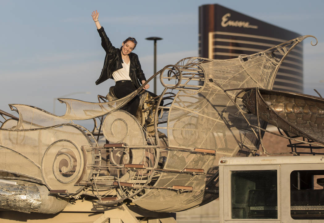 """Rose Donahue waves at a friend from the top of the art installation """"Balanceville"""" during the u ..."""
