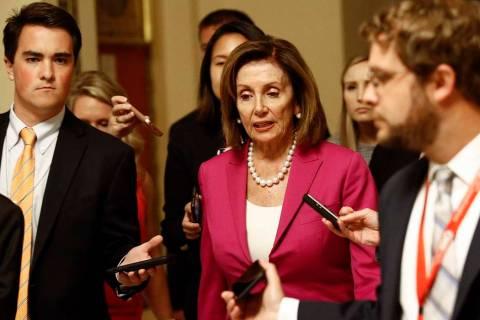 House Speaker Nancy Pelosi, D-Calif., walks to the House Chamber, Tuesday, July 16, 2019, on Ca ...
