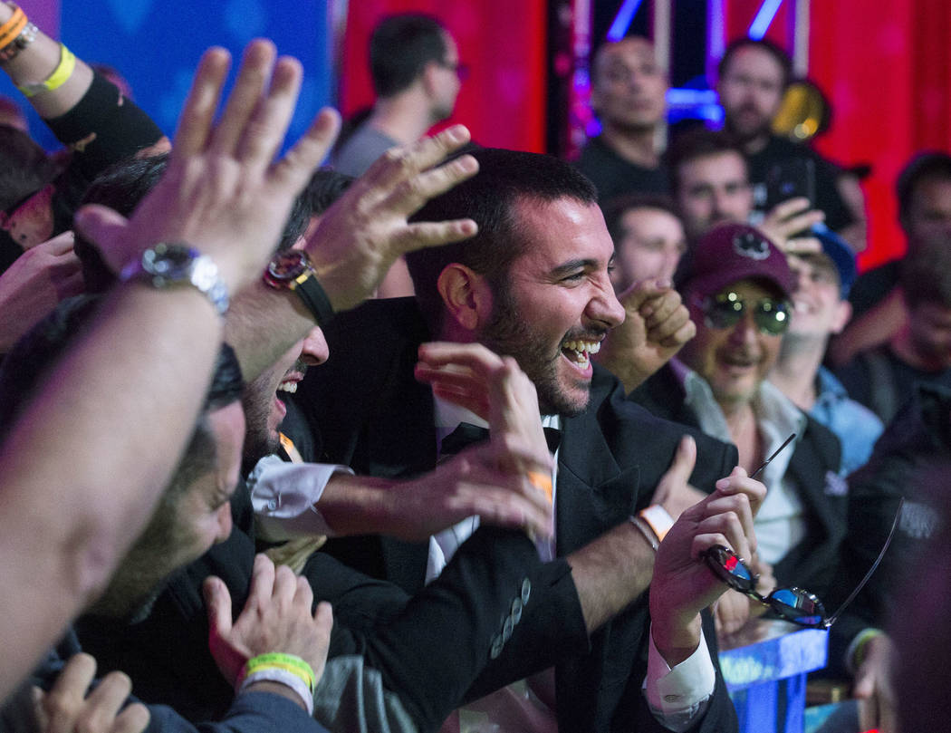 Fans mob Italian poker player Dario Sammartino, center, during a break at the World Series of P ...