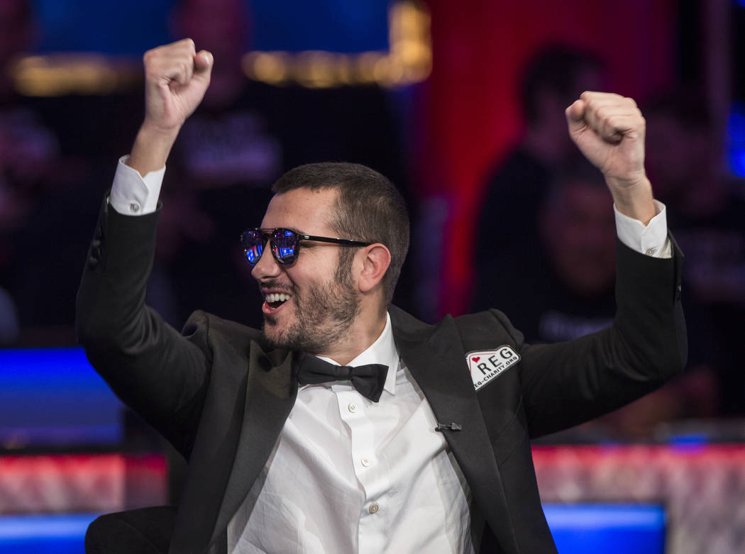 Dario Sammartino, from Italy, pumps his fists at fans during the World Series of Poker Main Eve ...