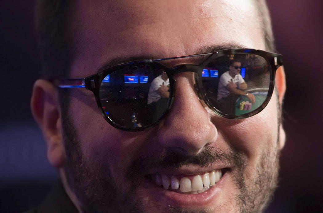 Dario Sammartino, from Italy, smiles at fans during the World Series of Poker Main Event on Tue ...