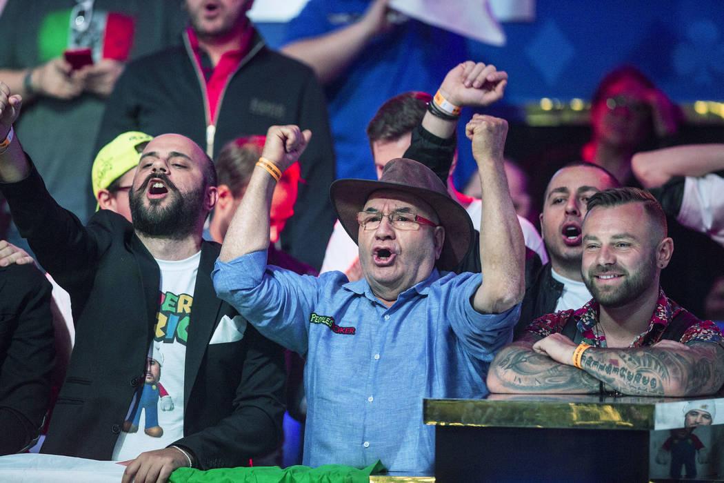 Fans of Italian poker player Dario Sammartino cheer during the World Series of Poker Main Even ...