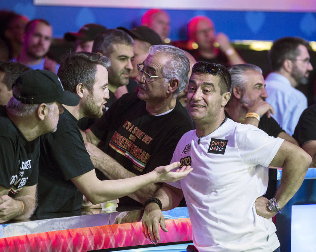 Hossein Ensan, right, from Germany, interacts with fans during the World Series of Poker Main E ...