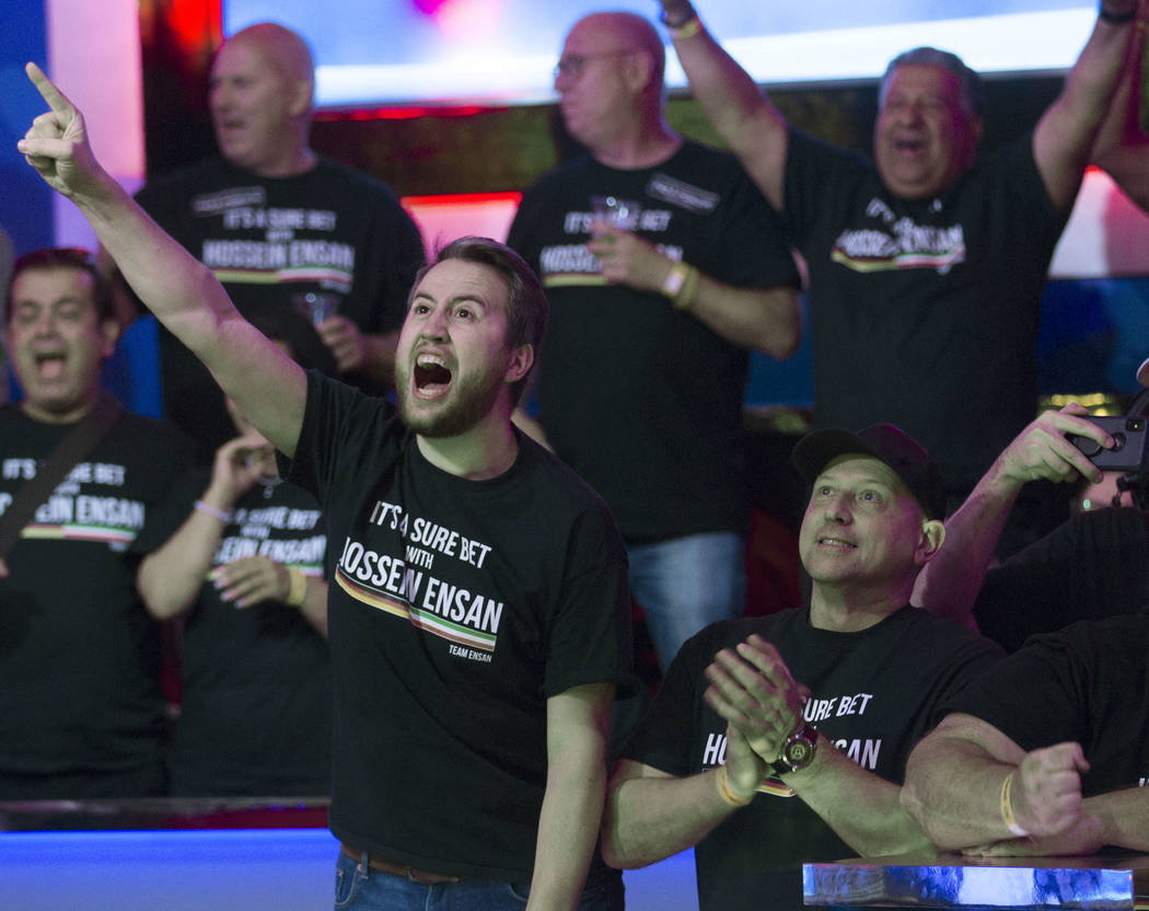 Fans of German poker player Hossein Ensan cheer during the World Series of Poker Main Event on ...