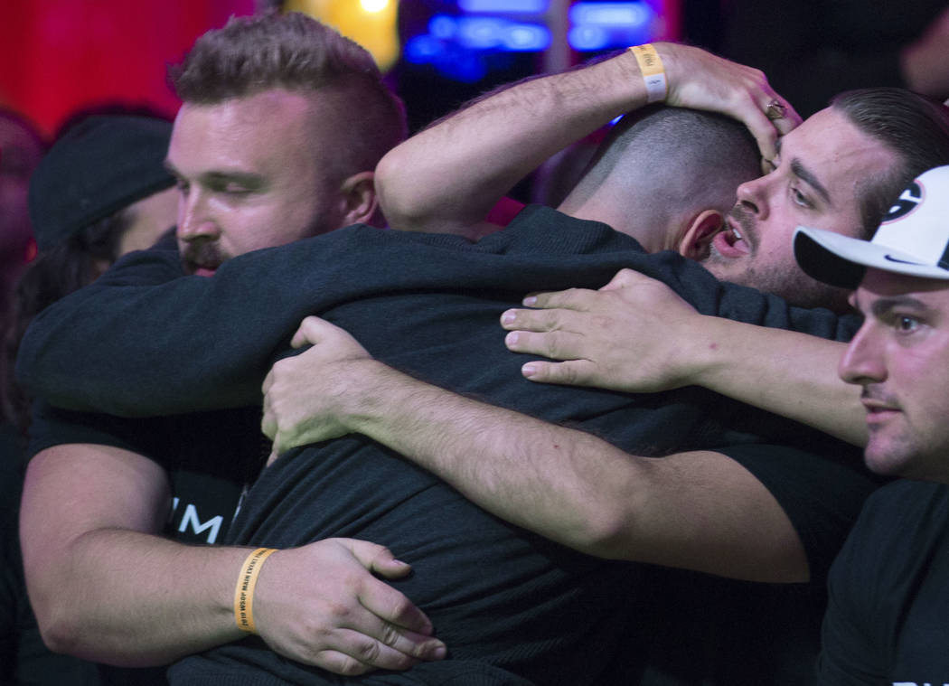 Alex Livingston, back, from Canada, is consoled by fans after being eliminated during the World ...