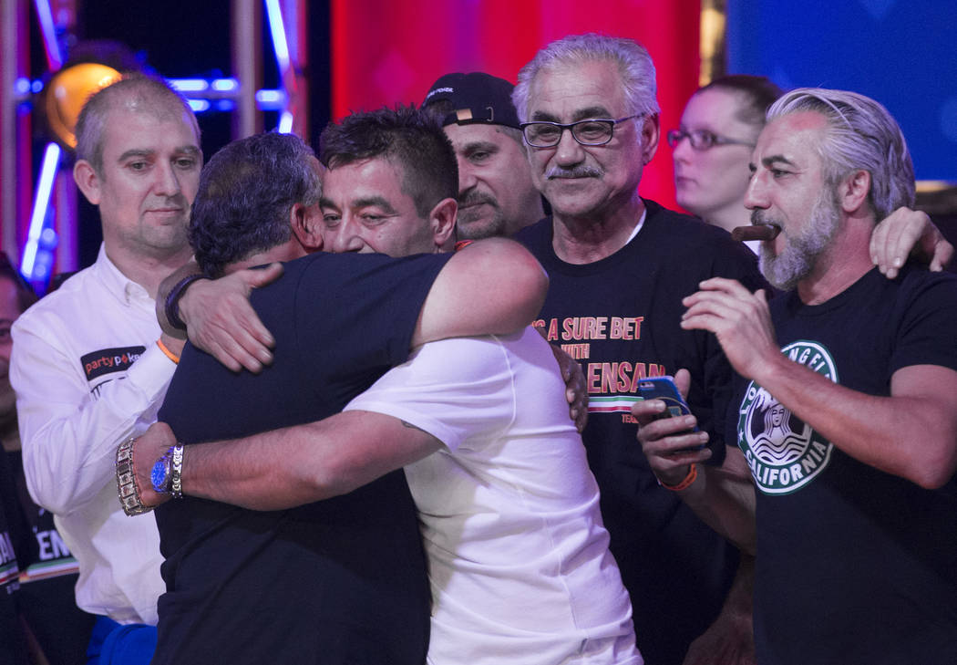Hossein Ensan hugs his supporters after winning the World Series of Poker Main Event on Wednesd ...