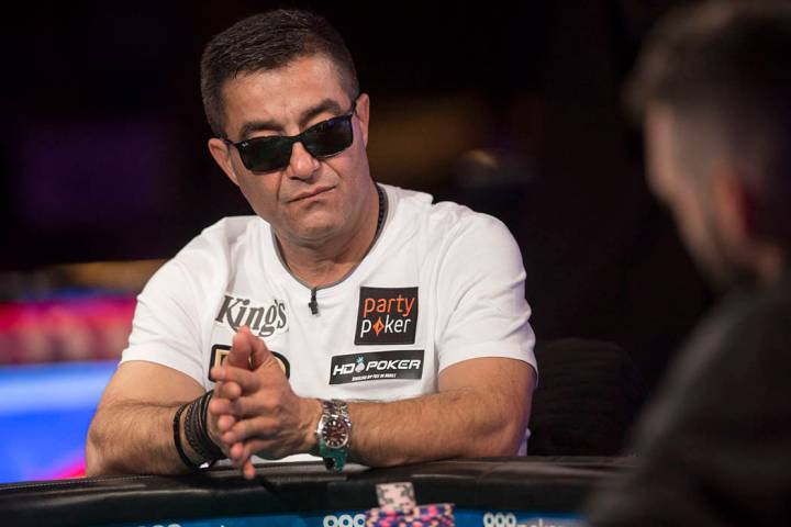 Hossein Ensan, from Germany, plays during the World Series of Poker Main Event on Tuesday, July ...