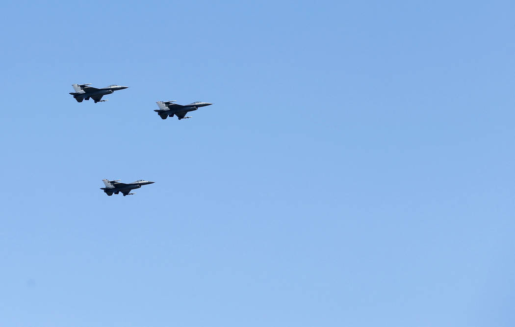 In honor of Ross Perot's commitment to the military and veterans, F-16 fighter jets fly during ...