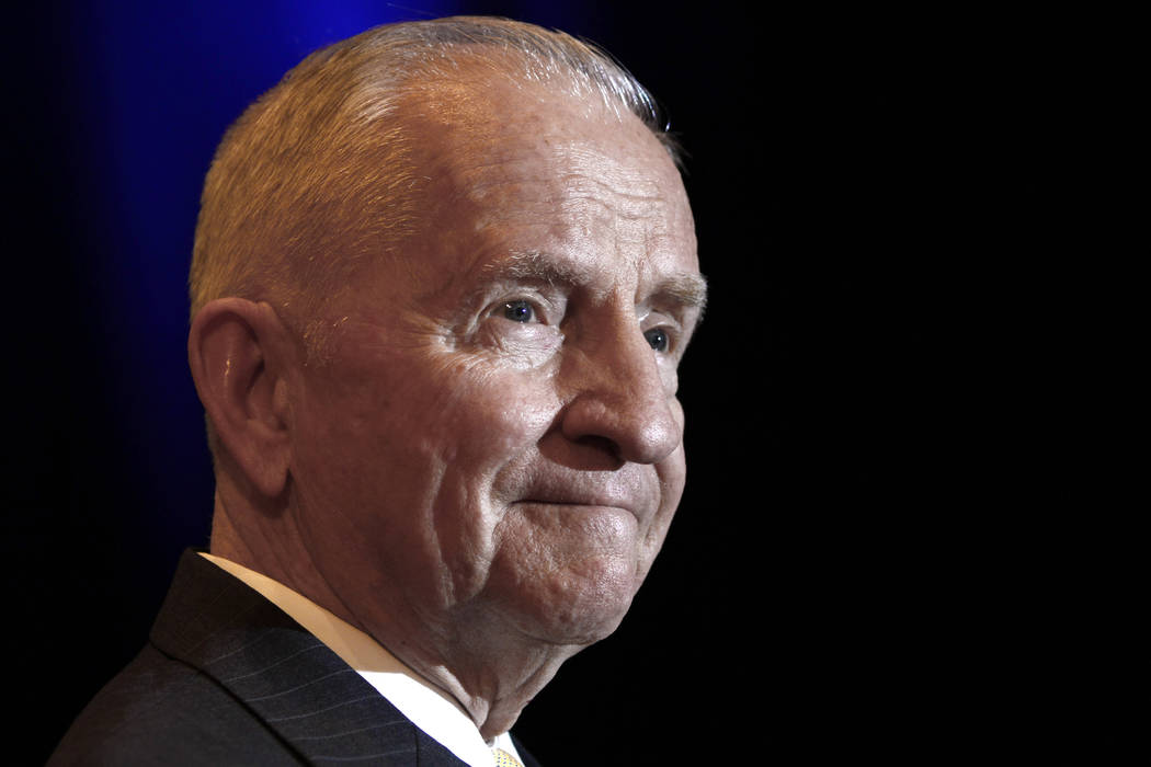 FILE - In this April 20, 2010, file photo, H. Ross Perot listens to a reporter's question durin ...