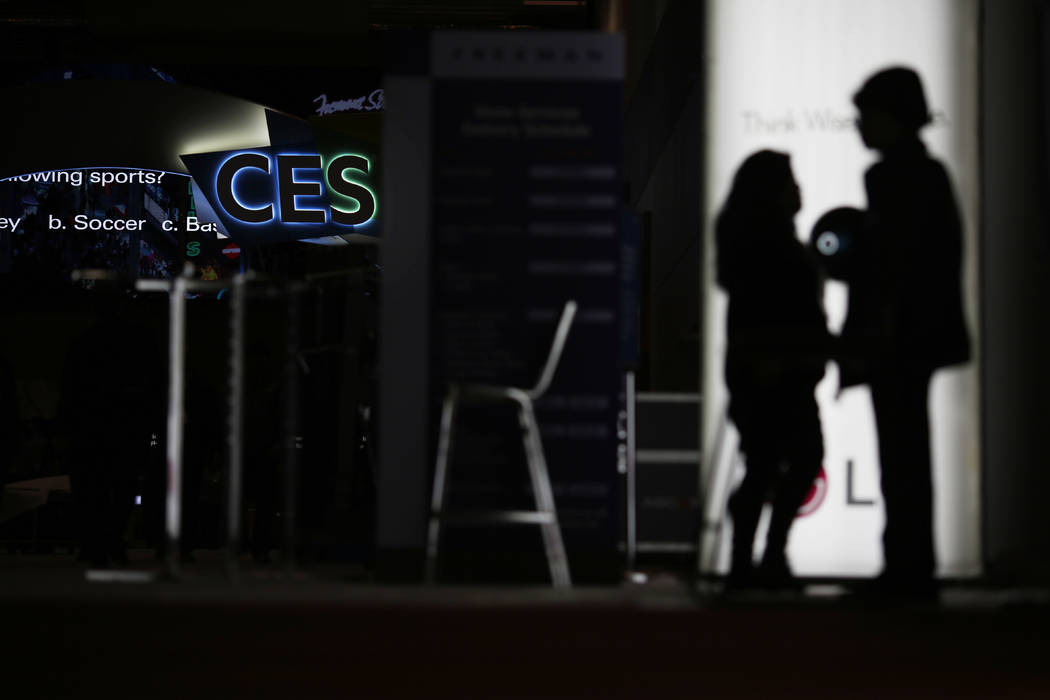 FILE - In this Jan. 5, 2019, file photo people walk around the Las Vegas Convention Center duri ...