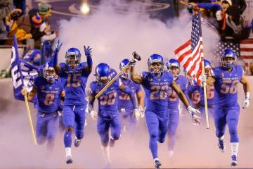 Boise State cornerback Avery Williams (26) carries the hammer as he leads Boise State on to the ...