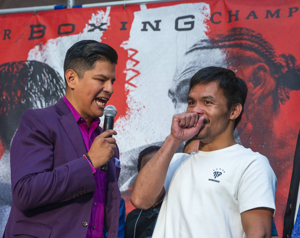 Emcee Ray Flores, left, interviews boxer Manny Pacquiao during his grand arrival to the MGM Gra ...