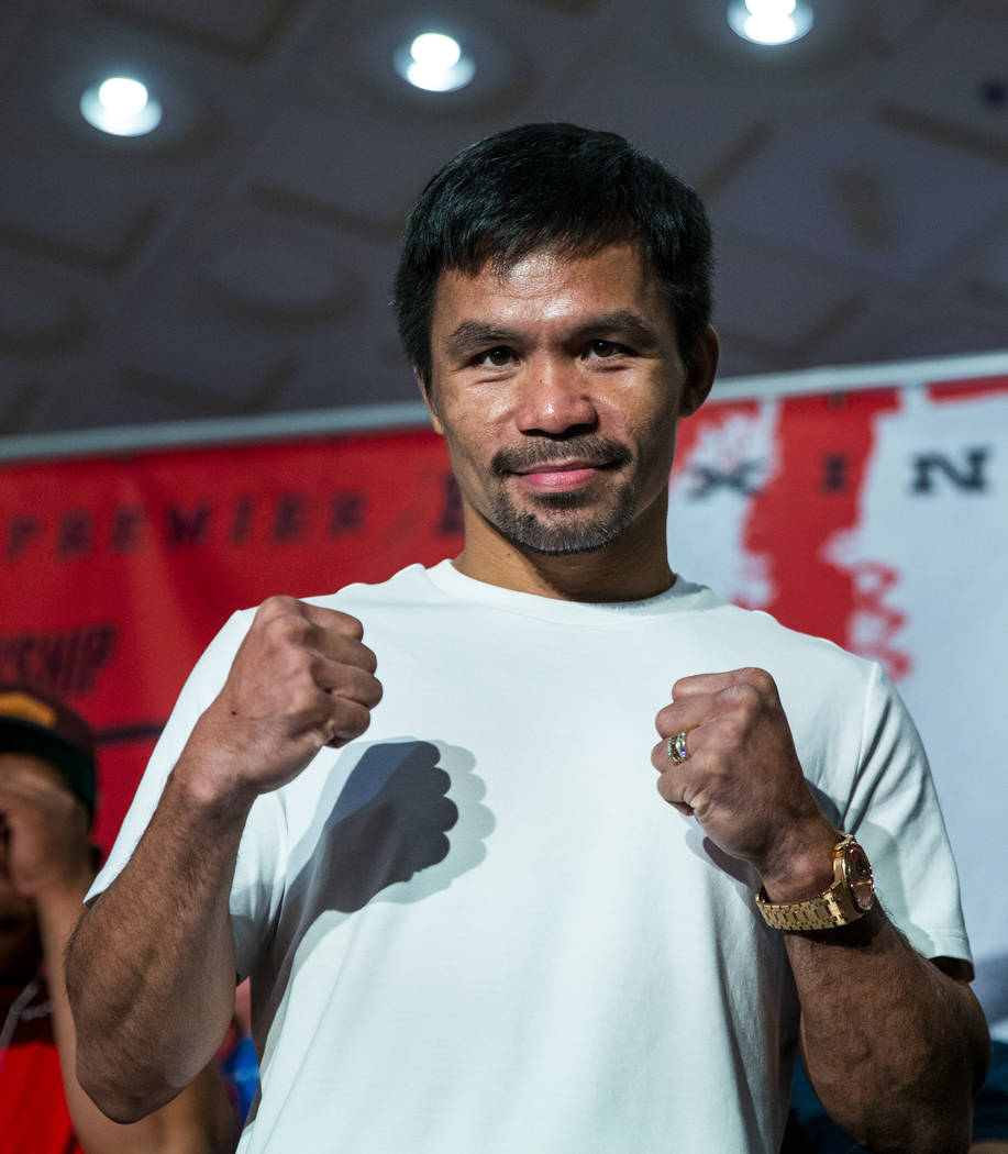 Boxer Manny Pacquiao poses for the crowd during his grand arrival to the MGM Grand on Tuesday, ...