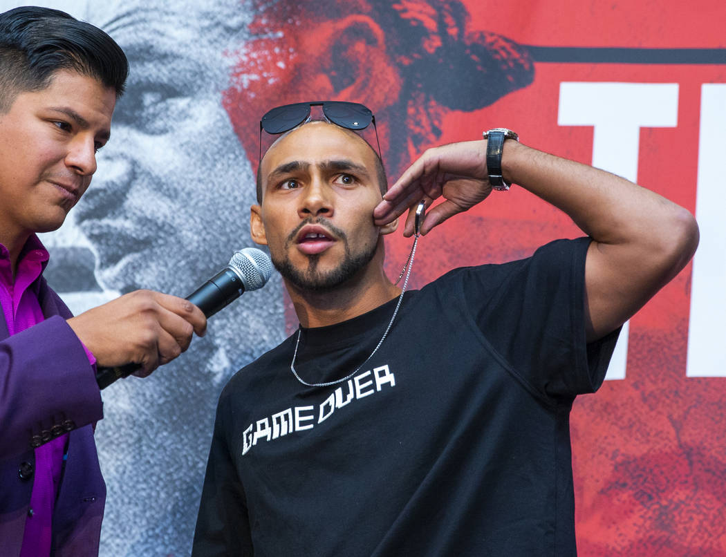 Emcee Ray Flores, left, interviews Boxer Keith Thurman during his grand arrival to the MGM Gran ...