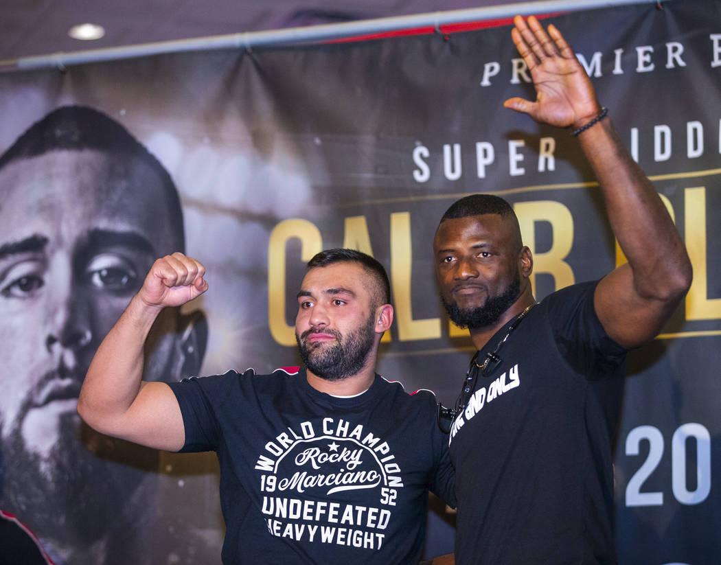 Boxers Eren Demirezen, left, joins his opponent Efe Ajaba during fighter grand arrivals at the ...