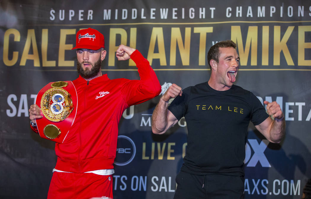 Boxers Caleb Plant, left, and Mike Lee pose for the fans during fighter grand arrivals at the M ...