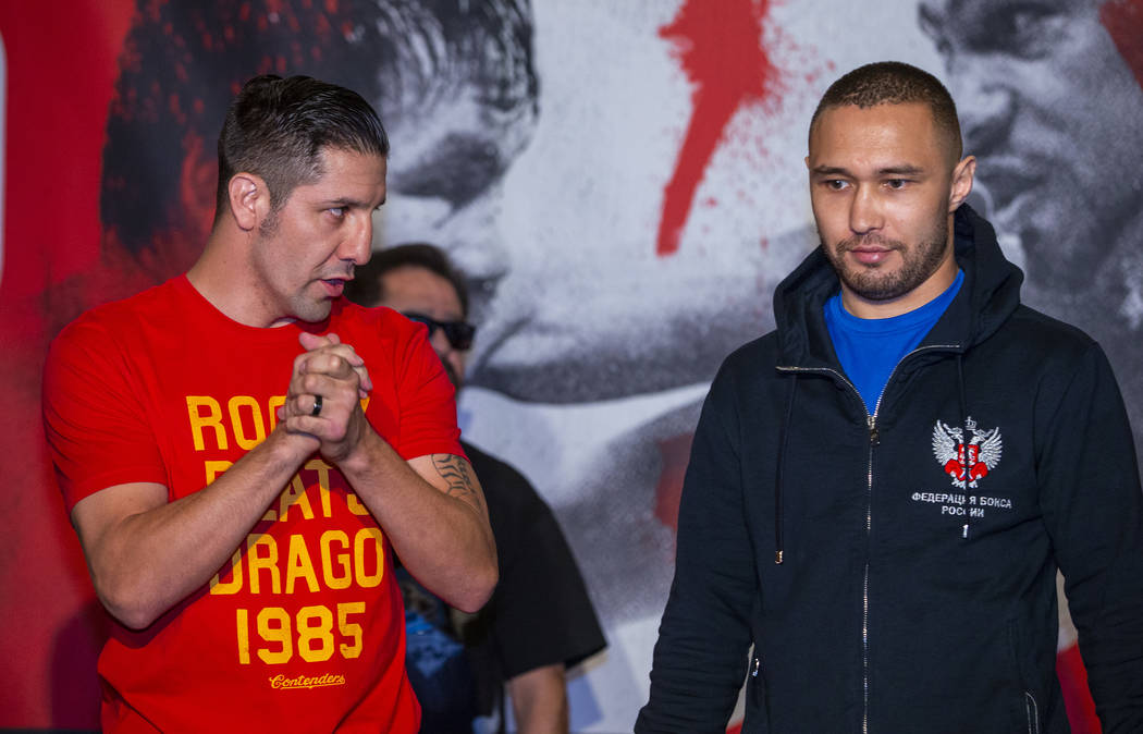 Boxer John Molina Jr., left, looks to opponent Sergey Lipinets during fighter grand arrivals at ...