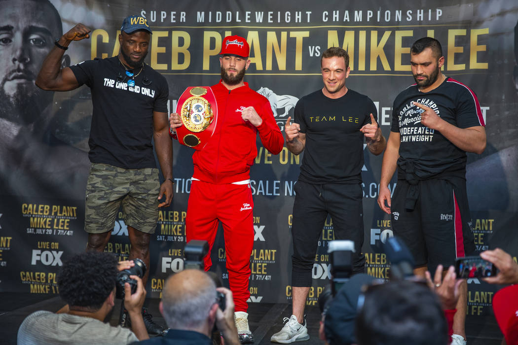 Boxers Efe Ajaba, from left, Caleb Plant, Mike Lee and Eren Demirezen pose for the fans on the ...