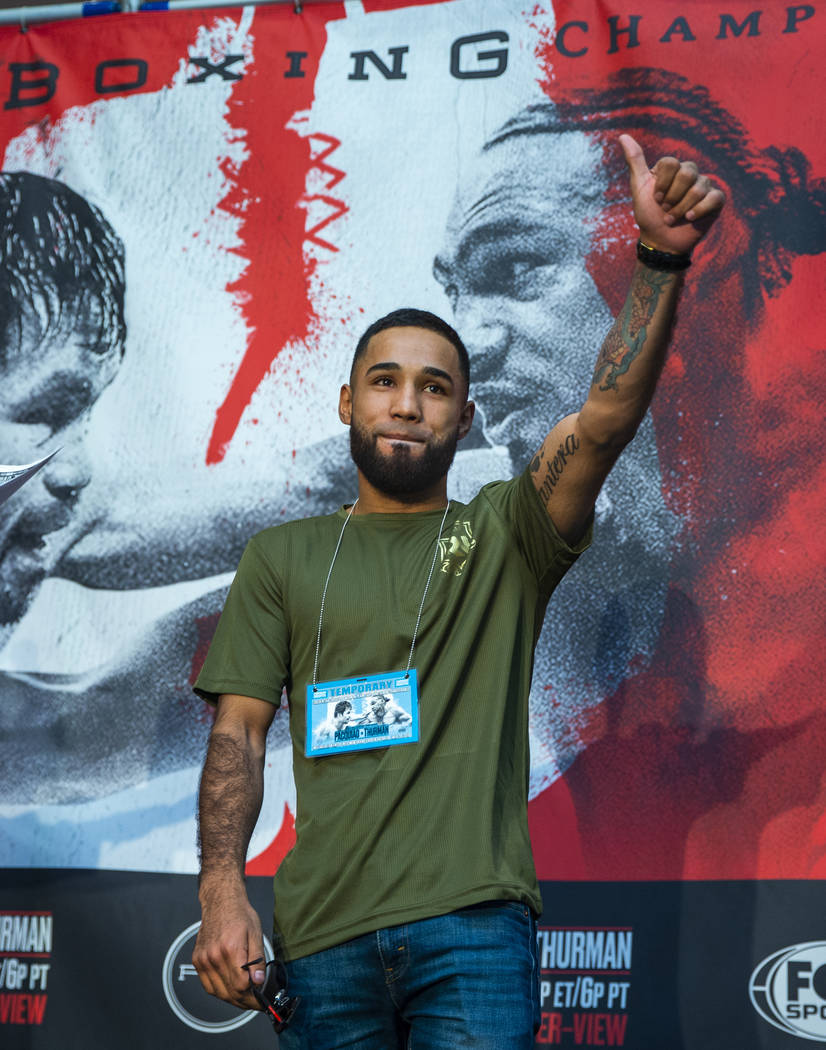 Boxer Luis Nery gives a thumbs up to the crowd during fighter grand arrivals at the MGM Grand o ...