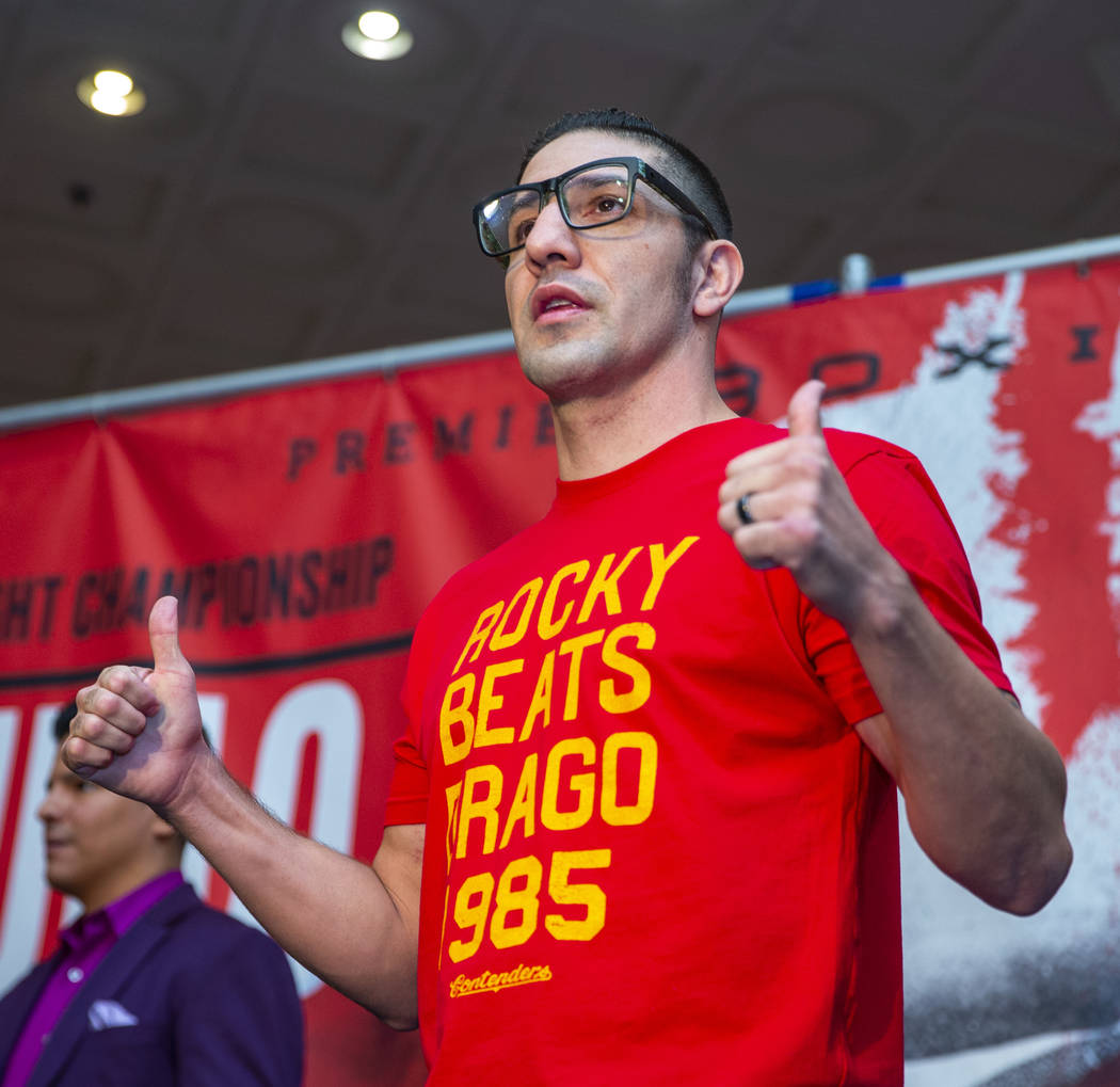 Boxer John Molina Jr. gives a thumbs up to the crowd during fighter grand arrivals at the MGM G ...