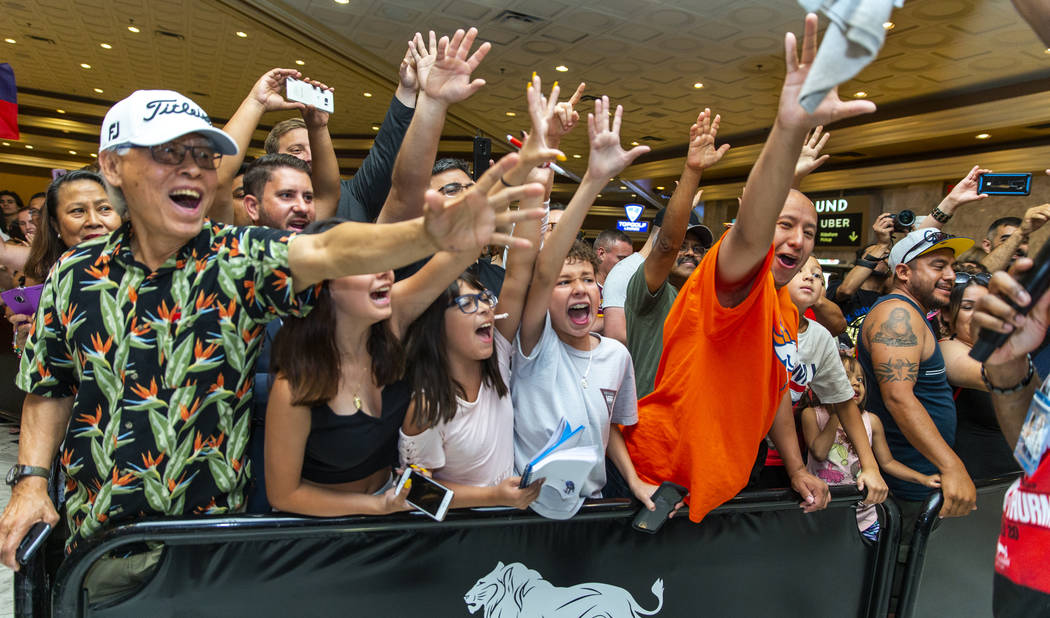 Fans go crazy as they scream for their favorite fighters during fighter grand arrivals at the M ...