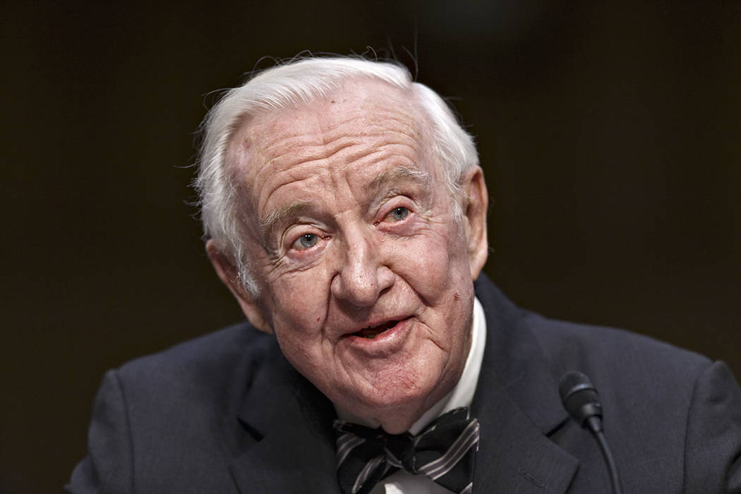 FILE - In this April 30, 2014, file photo, retired Supreme Court Justice John Paul Stevens test ...